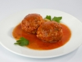 Meatballs with mushrooms in tomato sauce.